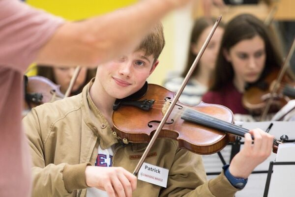 2018 Musis Generation Galway County Symphonic Waves Image of boy playing the violin.