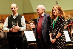 Paolo Cordone with his award presented to him by Philip O'Kane and Clare Daly (IAYO Chair)