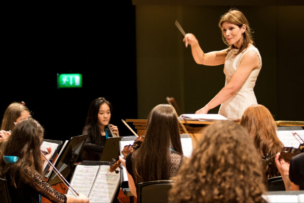 Mayo Youth Orchestras Musical Director, Anne Moriarty, conducting the orchestra at the 2018 Festival of Youth Orchestras. Photo by John Soffe Photography.