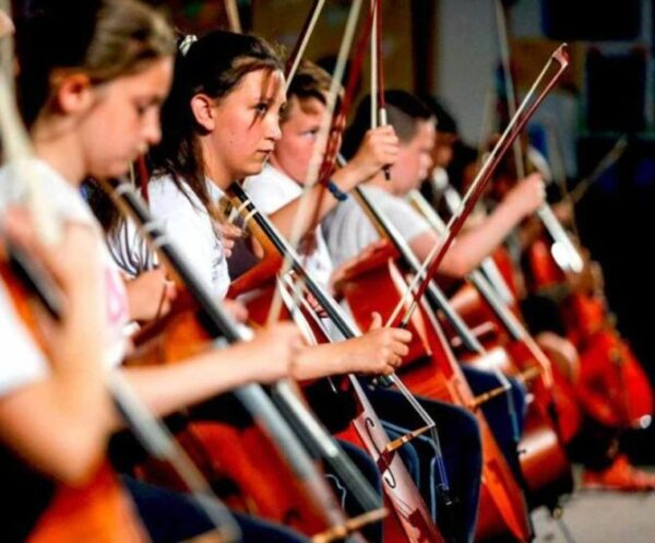 Music Capital Scheme image of young musicians playing cello