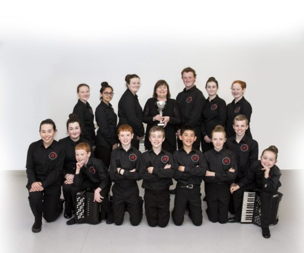 Accora Youth Orchestra with their musical director, Yvonne Chilton