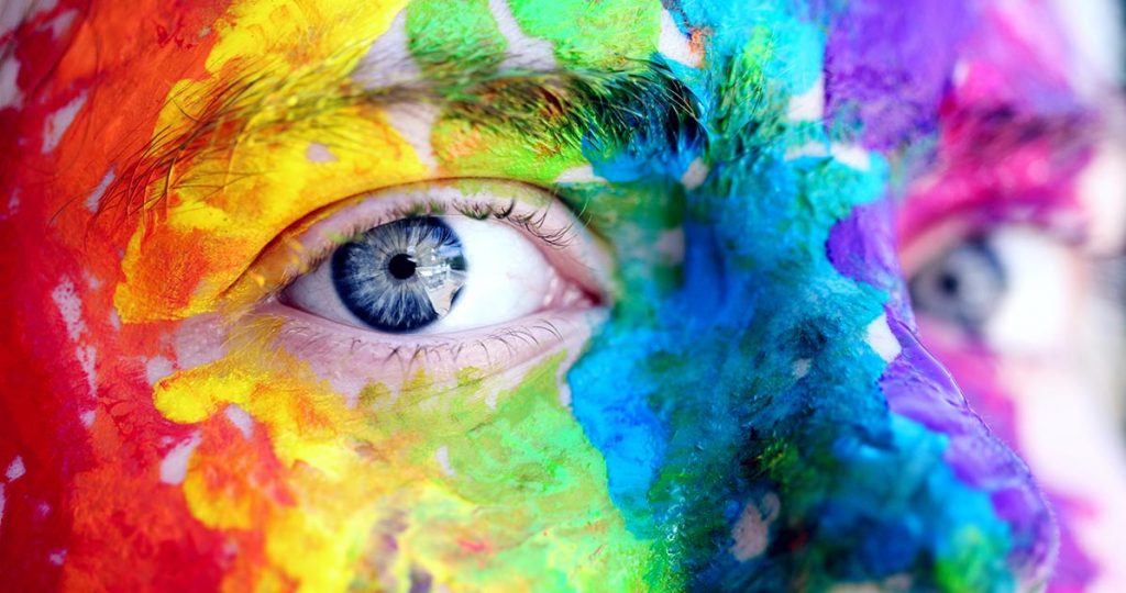 NYCI Youth Arts image of eyes surrounded by colourful paint.